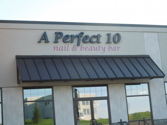 Exterior commercial signage creative surfaces for A perfect 10 nail salon rapid city
