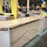 Custom Cambria Reception Desk for Gold's Gym
