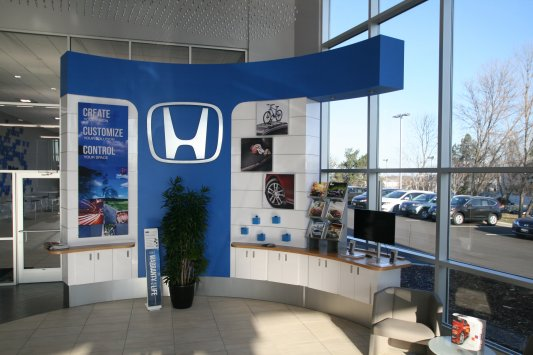 Automotive cabinetry and displays creative surfaces for Honda dealership burnsville mn